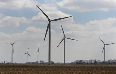 More wind farms like this one in Michigan may not be built in Ohio if lawmakers abolish rules requiring utilities to buy from Ohio-based projects.