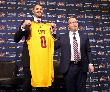 Kevin Love and David Griffin with Love's new uniform and number.