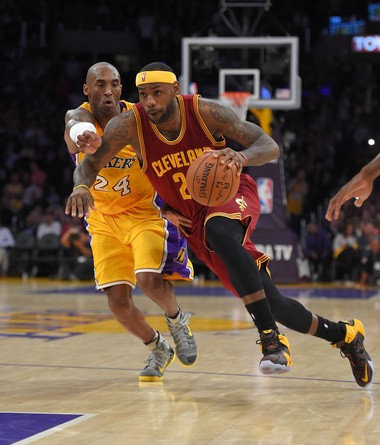 58fe3e68ec7 Cleveland Cavaliers forward LeBron James drives toward the basket as Los  Angeles Lakers guard Kobe Bryant