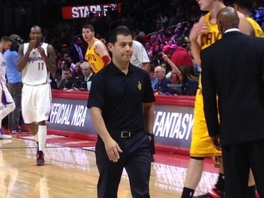 Michael Mancias, LeBron's personal trainer who also serves as an assistant on the Cavaliers' training staff, heads back to the bench following a timeout in Los Angeles Friday night.
