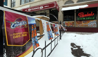 Panini's in downtown Cleveland displays banners supporting the Cleveland Cavaliers. Last season, the team averaged 17,330 fans per game, with five sellouts. This season the Cavs will sell out The Q for each of their 41 home games