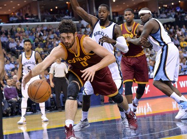 Cleveland Cavaliers forward Kevin Love (0) reaches for the ball in the first half of an NBA basketball game against the Memphis Grizzlies.