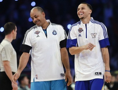 The Golden State Warriors' Stephen Curry celebrates with his father, Dell Curry, left, during the NBA All-Star Saturday Shooting Stars event Saturday, Feb. 14, 2015, in New York. Dell, a former Cavalier, said he was careful about how he taught his sons to play basketball. Stephen Curry was born in Akron during his father's time with the Cavs.