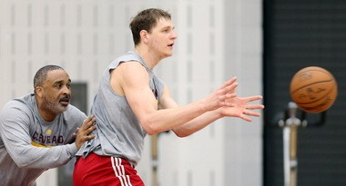 Cavs assistant coach Phil Handy, left, works out with center Timofey Mozgov during a practice. Handy, an Oakland native, had some tough words for the Cavs after their NBA Finals Game 2 loss, and it helped turn the tables for a Game 3 Cavs win Wednesday night.