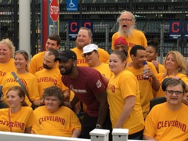 Kyrie Irving poses with Best Buddies, Ohio participants. Irving hosted a walk and basketball game for the charity Saturday.