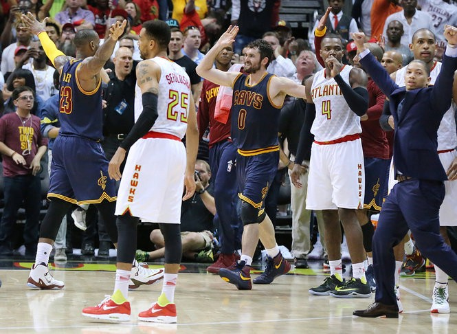 Atlanta Hawks' Thabo Sefolosha, from left, Paul Millsap and Al Horford react as Cleveland Cavaliers' LeBron James, Kevin Love and head coach Tyronn Lue celebrate a 100-99 victory to sweep the series on Sunday, May 8, 2016, at Philips Arena in Atlanta.