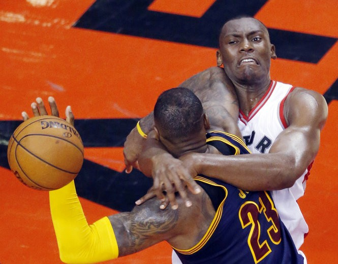 Toronto Raptors center Bismack Biyombo fouls Cleveland Cavaliers forward LeBron James hard in the second half. Biyombo was called for a technical foul. May 21, 2016.