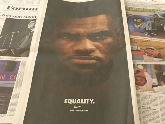 sports shoes d586d 54fa9 James  face stretches down the back of the Sunday Plain Dealer s sports  section as part of the campaign.
