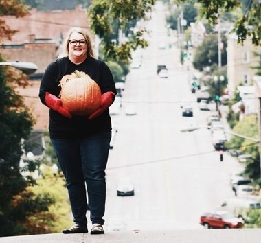 Molly Gebler stands at the top of Grove HIll to promote her film about the pumpkin roll.