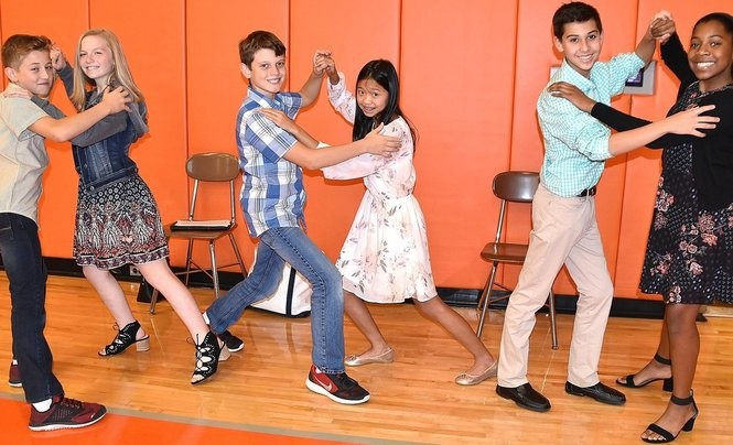 Orange students, Eric, Braverman, left, Anna Leitson, Pierce Pickett, Allie Yuan, Cooper Bryan and Courtney Taylor show their dance moves.