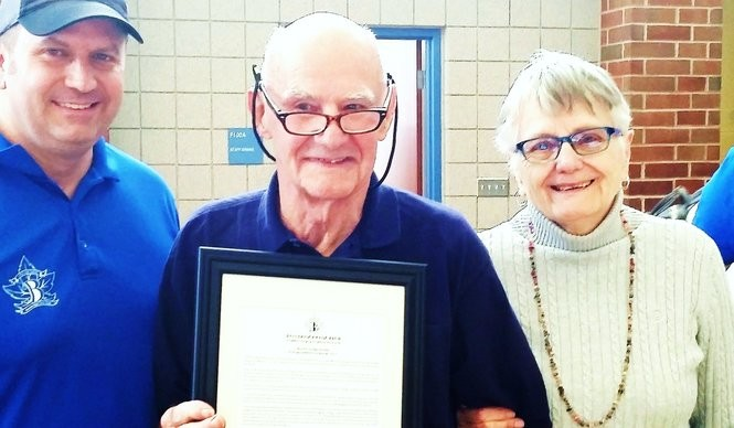 Harold Hissam, center, is honored by Bainbridge Civic Club President Justin Ryan, left, and his wife, Maggie.