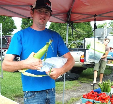 File photo of a produce vendor at the South Russell farm market.