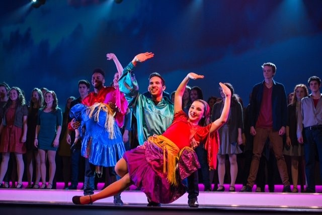 Up With People brings its colorful show to the Orange High School stage.
