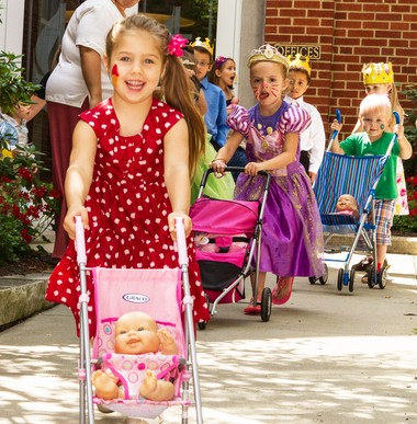 Lillian Steman, 4, of Auburn Township takes her place in the baby stroller race. The race was an activity at the English Nanny and Governess School's celebration of England's Prince George's recent birth. The party took place July 30.