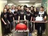 A few of the students from Orange High SchoolÂÂs roboticÂÂs team pose with Archimedes, a robot they created from scratch for competition that can lift an exercise ball and throw it with accuracy.