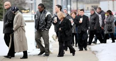 Family members and friends of Chardon high school shooting victims arrive at Geauga County Common Pleas Court ,Tuesday, March 19, 2013 for the sentencing of T.J. Lane.