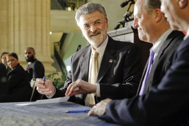 Cleveland Mayor Frank Jackson and leaders of several key business, civic, labor and trade organizations sign a sweeping agreement, pledging to hire local and support training programs that strengthen Cleveland's workforce.
