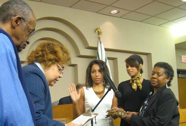 Janine Boyd, center, is sworn into Cleveland Heights City Council by her mother, state Rep. Barbara Boyd (D-Cleveland Heights). Janine Boyd replaced the late Phyllis Evans, pictured at far right. Janine Boyd now is running for her mom's seat in the Ohio House. Barbara Boyd's term ends in December.