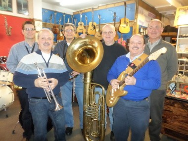 The Academy Music Company staff includes, from left, Dave Sterner, Rick Ianni, Mal Barron, Kevin Dunipace, Dave Iosue, and Tom Ianni.