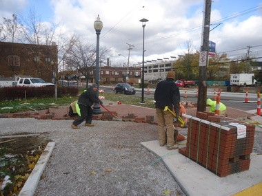 As this crew from Extreme Elements of Akron wraps up some brickwork on the $3.5 million Lee Road streetscape project, the Greater Cleveland Congregations group would like to see Cleveland Heights turn its attention -- and some of its budget surplus -- toward the Noble neighborhood.