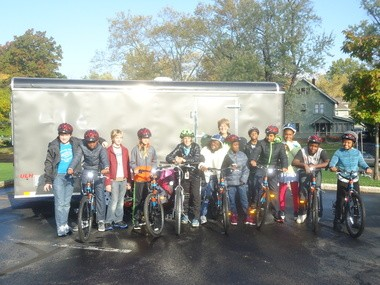 Fairfax Elementary physical education teacher Alice Stratton, center, wraps up one of her Oct. 25 gym classes riding the newly-acquired Bike Fleet around the school campus. In the back is Councilwoman and Heights Bicycle Coalition President Mary Dunbar.
