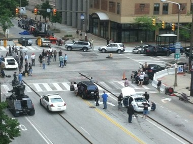 """The intersection of Superior Avenue and East Ninth Street was the scene of numerous police car crashes Wednesday during the filming of """"Captain America: The Winter Soldier."""""""