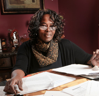 Yvette Jones goes over letters and forms she collected in her effort to get out of reach of a scam school she briefly attended in the mid-80s. Many students victimized by sham schools continue to wrestle with debt from student loans.
