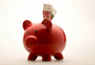It doesn't have to just be you and your piggy bank anymore. A new program offers one-on-one financial coaching.