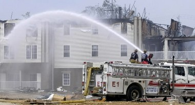 Stow firefighters helped to douse this blaze in Cuyahoga Falls in 2002.