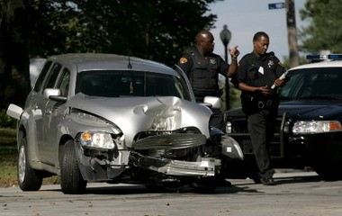 Cleveland police investigate the scene of a shooting on Martin Luther King Jr. Boulevard, Sept. 10, 2008, in which an officer shot Gatha Dye III, 21, after he refused to stop what officers believed was a stolen car.