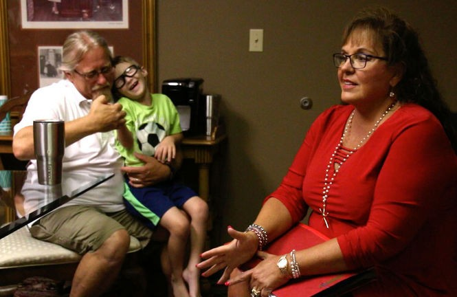 Attorney Anna Villarreal (right) speaks in her office in Chillicothe on June 28. To her left are James Rout and his grandchild Gabriel Detty.