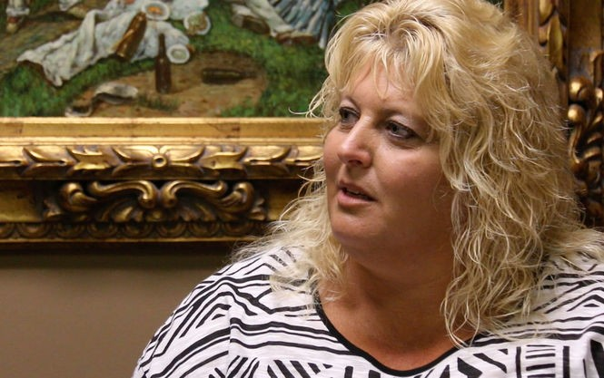Tabitha Smalley talks about the medical issues for her adoptive son Liam on her attorney's office in Chillicothe on June 28.