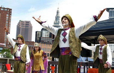 Ajyal, a troupe of Lebanese dancers, performs a line dance known as dabke, or stamping of the feet, during the Cultural Birthday Extravaganza in July 2012 in Cleveland.