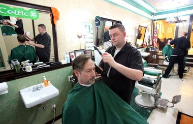 Sean Gormley (right), runs both his Irish Barber shop and adjacent Irish Corner Pub in Rocky River, giving customers a chance to have a beer while they wait for a cut.