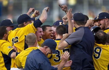 Kent State celebrates a victory over Oregon en route to the 2012 College Baseball World Series.