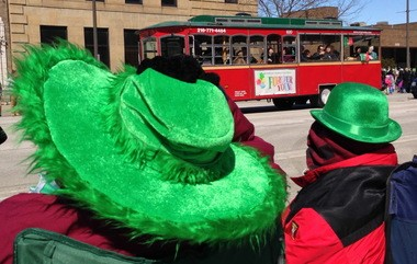 Sandy McDevitt of Fairview Park fights to keep her hat attached during the 2014 St. Patrick's Day Parade in Cleveland. Fairview Park has the highest concentration of Irish in Ohio.