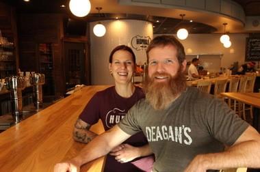 Co-owners Mandi Bernot and Dan Deagan take a break at the bar at Humble Wine Bar in Lakewood.