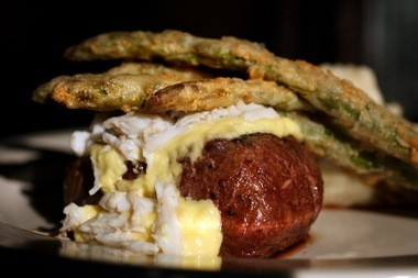 Filet Oscar, a filet mignon covered in crab, crispy asparagus and bearnaise sauce is a popular classic steakhouse selection available at the Cleveland Chop in the Warehouse District in downtown Cleveland.