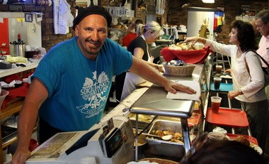 Bernie Sokolowski, the oldest of three siblings who run Sokolowski's University Inn, manages a busy buffet line brimming with Polish and American fare.