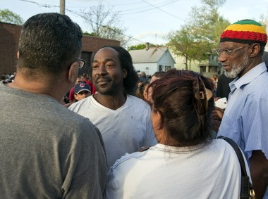 Onlookers, media speak to Charles Ramsey (center) after he helped free Amanda Berry from 10 years being held captive in a west side Cleveland home.