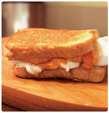"""Don't want to wait for the holidays for an autumn favorite? Sweet potatoes and marshmallows are surprise ingredients in the Harvest Fest grilled cheese sandwich, from Shane Kearns' cookbook """"Melt: 100 Amazing Adventures in Grilled Cheese."""""""