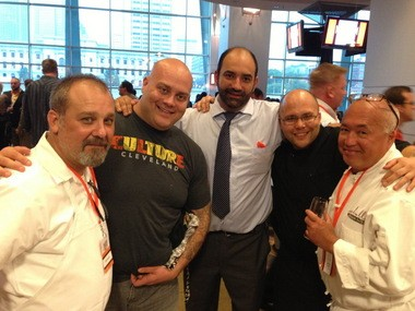 Rocco Whalen (second from left) and other area chefs have long been involved in supporting Cleveland Foodbank and other hunger relief efforts. In this photograph from the 15th annual Taste of the Browns fundraiser at FirstEnergy Stadium last summer are Tim Bando (Deagan's Kitchen), Rocco Whalen (Fahrenheit, Rosie & Rocco's), Fabio Salerno and Lanny Chin (Lago East Bank), and Ron Seballos (Seballos Pastries).