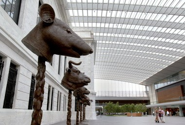 Ai Weiwei's Chinese zodiac animals are on view in the atrium of the Cleveland Museum of Art in an installation that hauntingly recalls an 18th century Beijing palace plundered by European troops in the Second Opium War in 1860.