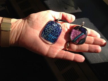 Marsha Dobrzynski held two glass pendants made by Young Audiences students at North Ridgeville High School in a class taught by Avon artist Sheree Ferrato.