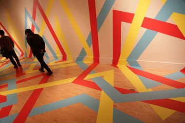 """Visitors peruse the ArtPrize entry, """"Merdian,"""" an adhesive-backed vinyl installation by Lauren Cotton."""