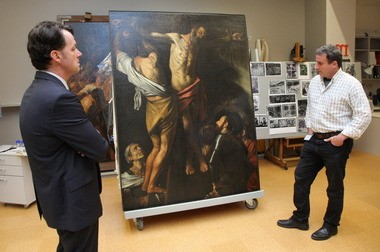 David Franklin inspecting a Caravaggio in the Cleveland Museum of Art's conservation lab with conservator Dean Yoder on Thursday, May 23.