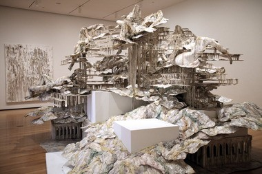 """Nolli's Orders,"" by Diana Al-Hadid, combines fluid forms cast in foam and polymer gypsum and solid, rectilinear shapes made of plywood in a way that evokes the Baroque energy of a Roman fountain."