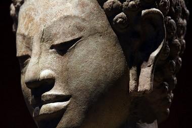 Possessor of wisdom: A detail of Buddha, 600s, Sandstone, Thailand, probably Shri Thep.