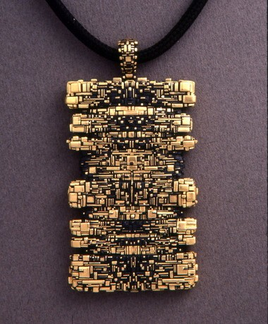 John Paul Miller, the genius goldsmith of Cleveland who made this pendant and other masterpieces, died in 2013.