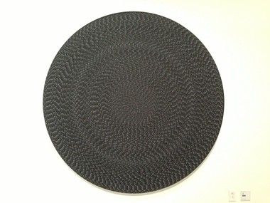 """One of Grabner's mesmerizing """"Tondo,"""" or round paintings."""
